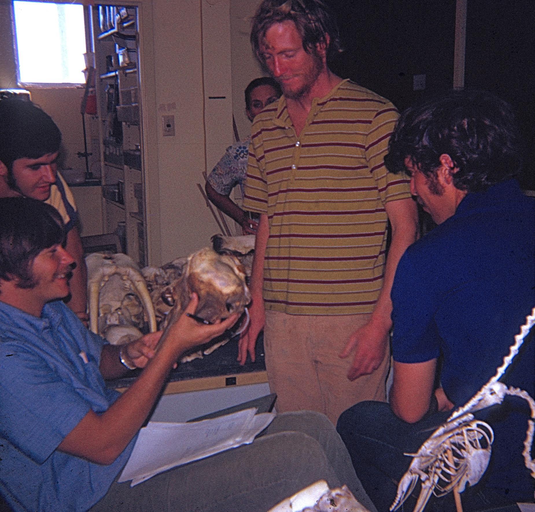 Milos et al. with mammal bones in museum McMasters Photo
