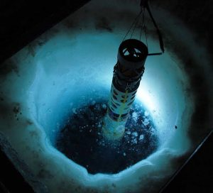 SCINI ROV diving through a hole in the ice in Antarctica