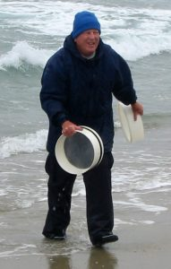John Oliver sampling on the beach.