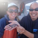 Bonnie B. and Captain Allen C. holding a baby blue rockfish on a CCFRP trip