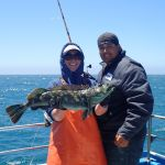Bonnie B. and Joseph F. holding a green lingcod on a CCFRP trip