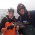Bonnie B. and Kris H. holding a black rockfish on a CCFRP trip