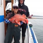 Jen C. and Nick I. with a vermilion rockfish on a CCFRP trip
