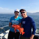 Jackie M. and Jessie R. holding a vermilion rockfish on a CCFRP trip