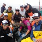 Roy Q., Jackie M., Mike C., Jen C., Captain Tom M., Katie C., Bonnie B. and Joaquin C. gathered around a Cabezon on a CCFRP trip