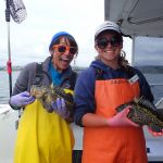 Vicky V. and Bonnie B. each holding a china rockfish on a CCFRP trip