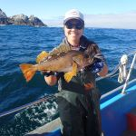 Jen C. with a yellowtail rockfish on a CCFRP trip