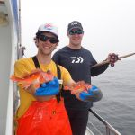 Ryan F. and Nick I. with two rosy rockfish on a CCFRP trip