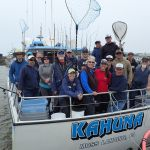 Volunteer anglers and science crew on the kahuna at the end of a CCFRP trip