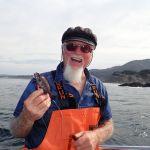 Frank P. with a tiny juvenile blue rockfish on a CCFRP trip