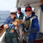 Jen C., Captain Tom M., and Ken Y. with a quillback rockfish on a CCFRP trip