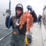 Jack J. about to descend a Canary Rockfish and a Copper Rockfish on a CCFRP trip