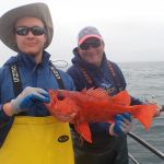 Cardozo and Honkola holding a Vermilion rockfish on a CCFRP trip