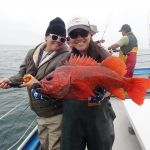 Marshall and Chiu holding a vermilion rockfish caught on a CCFRP trip