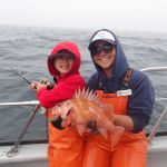 Science crew member B.Brown holds up SooHoo's Copper rockfish