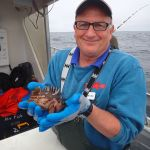 R.Starr holding a Gopher rockfish on a CCFRP trip
