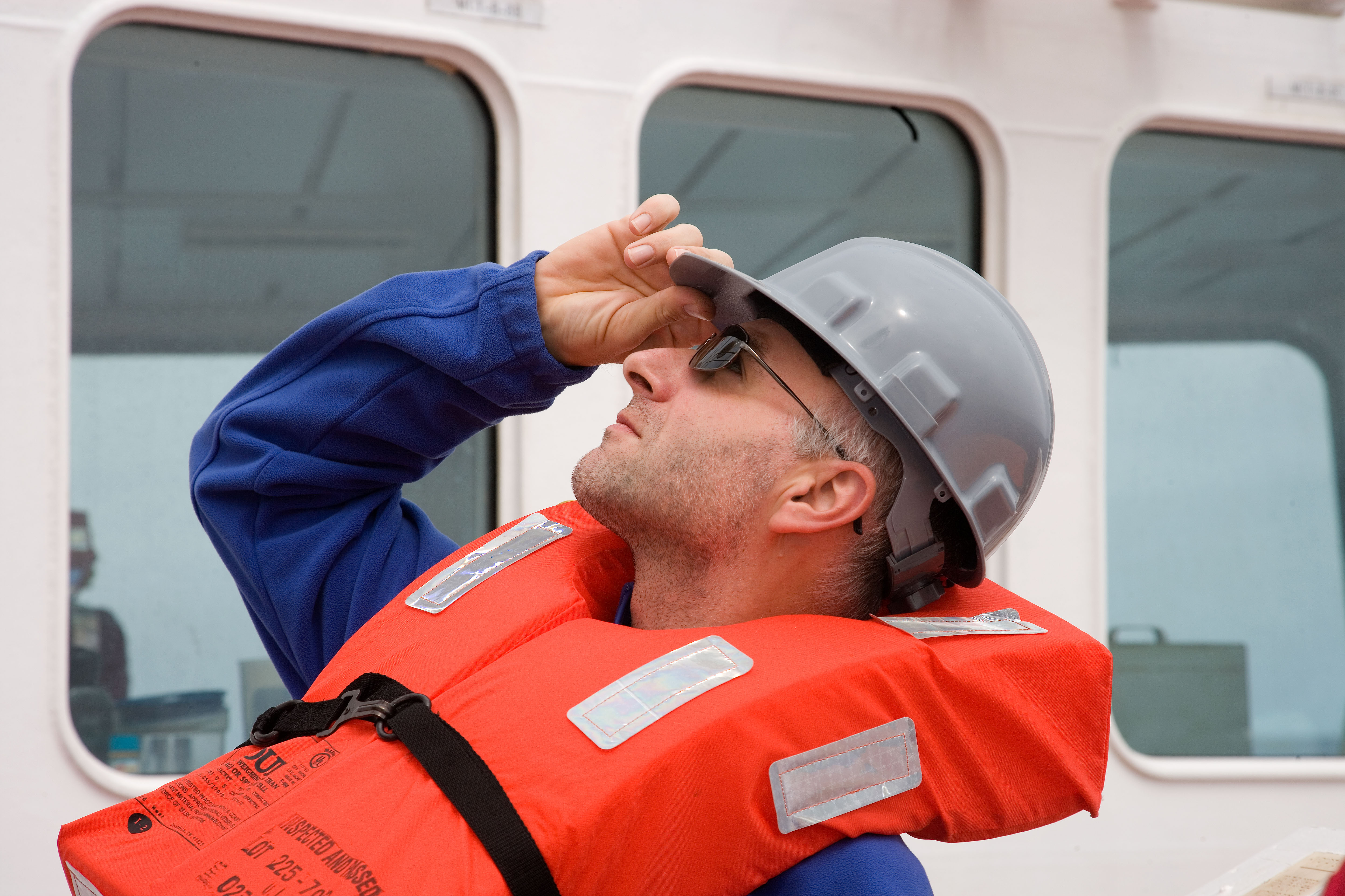 Ivano Aiello, sedimentologist reacts to the rather loud ships horn that is sounded during weekly life boat drills