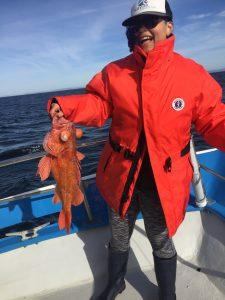 Helaina Lindsey holding a rockfish
