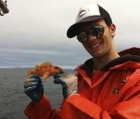 Ryan Fields holding rosy rockfish