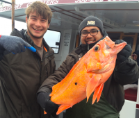 Isidro Blanco and Travis Brooks holding Canary Rockfish caught off Washington