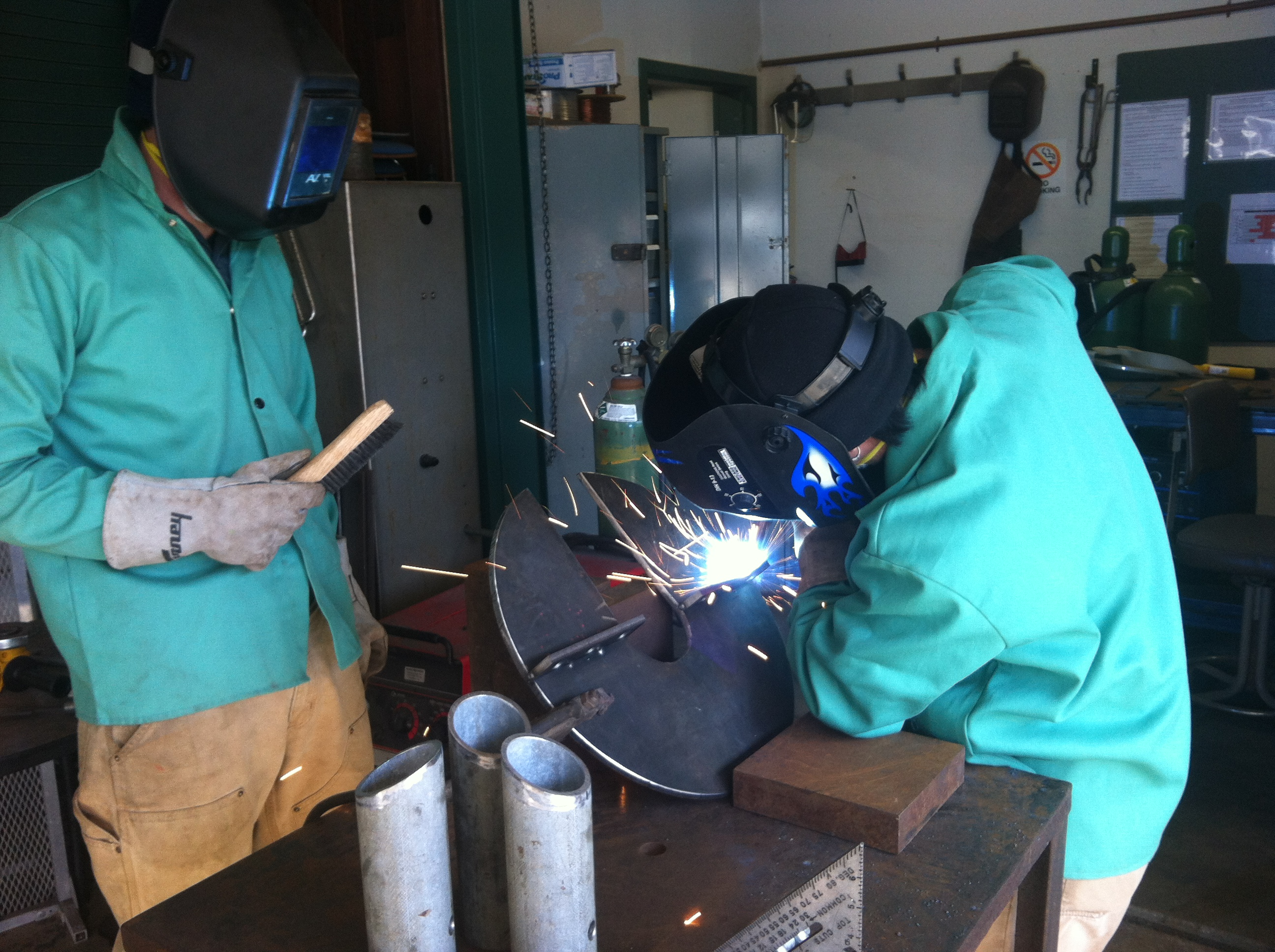 Paul Clerkin uses a MIG welder to attach pieces to the top of our tripod. Photo by: Catherine Drake