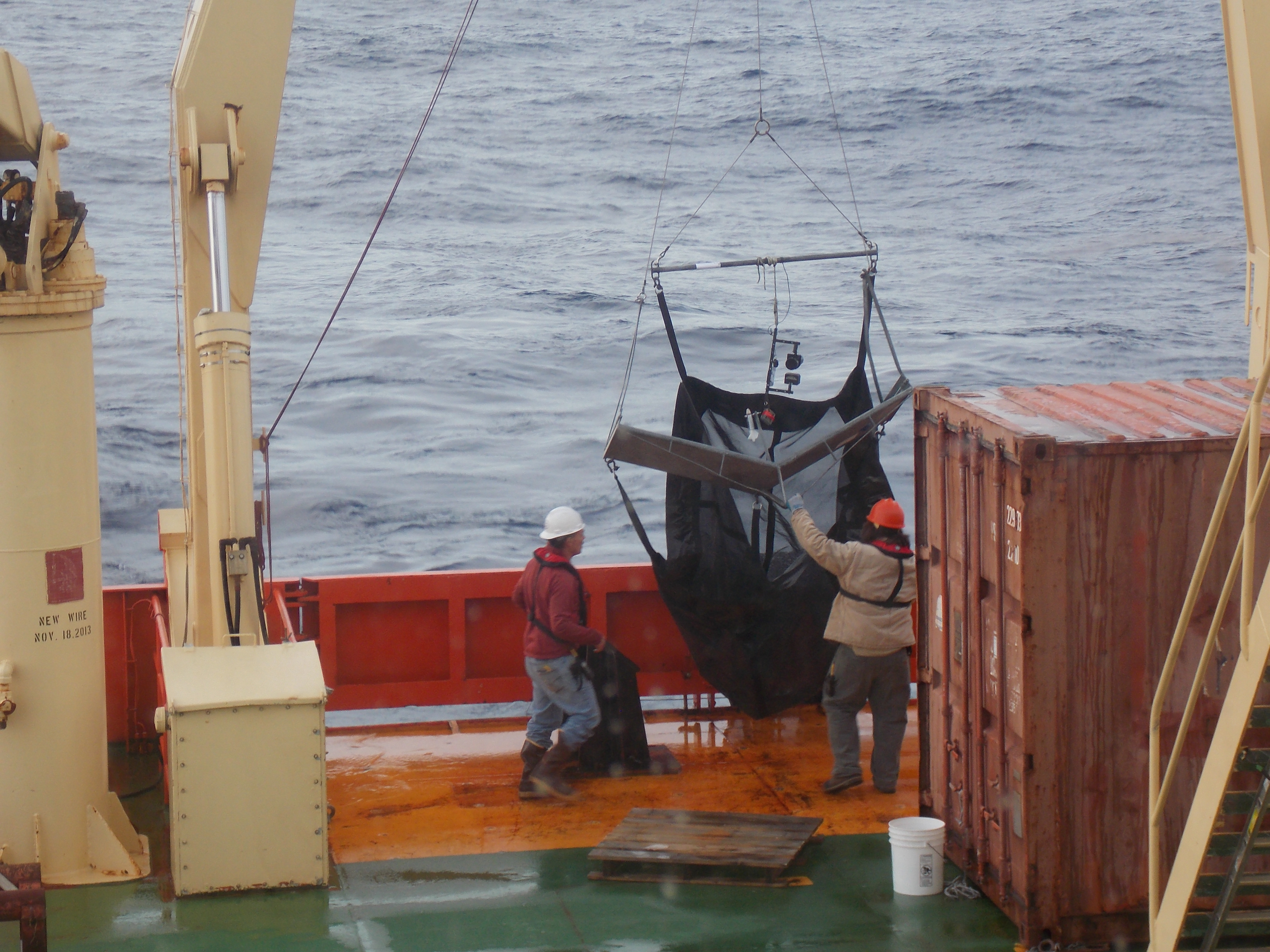 The marine technicians pulling in our net, an Isaacs Kidd Midwater.