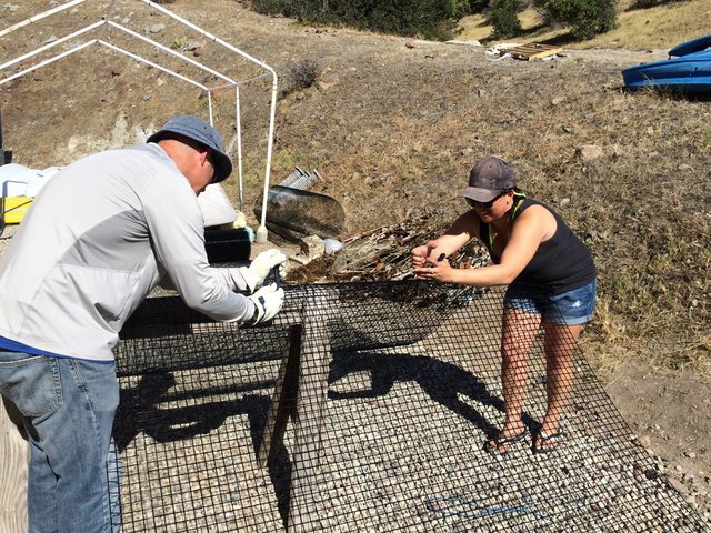 Dr. Mark Steel and graduate student Alexis Estrada constructing one of the cages that would be going over our reefs. Photo by Dr. Mia Adreani.
