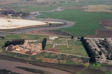 Aerial shot of MLML during the construction process, demonstrating that the building was built on an ancient dune. You can see the bare land around the lab space that was cleared of all legless lizards before construction began.