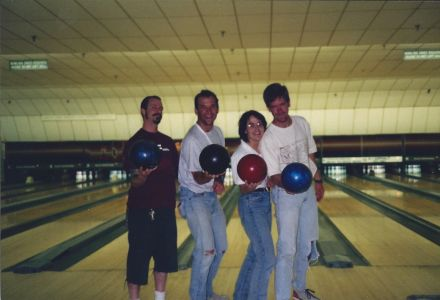 Figure 12. Team B.U.I. at 1997 Bowling Tournament. Pictured left to right: Pat Iampietro, Matt Edwards (with arm in sling; what a trouper!), Erica Burton, and Stewart Lamerdin.